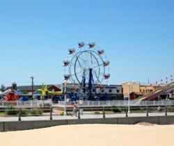 Ferris wheel at Virginia Beach provides a bird's eye view of the boardwalk, beach and sea.