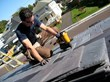 Mark Clement installs DaVinci polymer roofing tiles.
