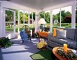 A sunroom from Venetian Builders, Inc., Miami. Sunrooms add 4 season living space that's usable day and night.