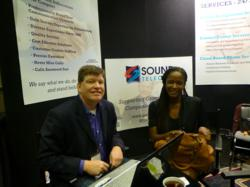 This is a picture of Joan Webley being interviewed by Kevin Price at GrowCo 2013 as part of Sound Telecom's Entrepreneurship Series. Sound Telecom is a nationwide provider of outsourced telephone answering services, contact center solutions and cloud-bas