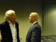 This is a picture taken by Michael LaBaw, founder of Sound Telecom a nationwide provider of outsourced telephone answering, contact center and cloud based phone systems of Richard Branson greeting Mitch Landrieu at GrowCo 2013 in New Orleans