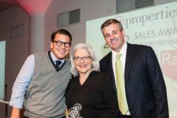 Kevin Wood accepts an award from @properties co-founders Thaddeus Wong and Michael Golden at the 2012 @awards.