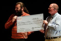 The winning team: Benjamin Erbach, left, toting the winning $4,000 check with partner Scott Miller