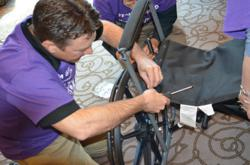 griswold home care team member building wheelchair