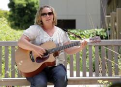 Ali Gilmore singing for Tri-City Medical Fundraiser