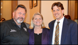 ABATE Board member, Mike Olinger, Secretary of State, Ruth Johnson, and Motorcycle Attorney Dondi Vesprini at ABATE event at State Capitol