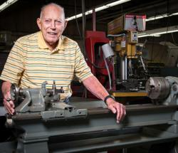 Roy Dunlap pictured in 2012 with his first lathe, which is still in working condition.
