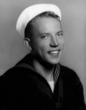 Roy as a U.S. Navy man before he opened his business.