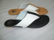 A brown and a black sandal with leather outsole and canvas uppers from Lady Ease Collection