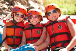 Kids smile on raft trip with Echo Canyon