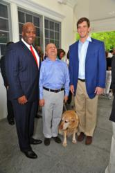 L-R: Entergy Chief Administrative Officer Rod West and Omar Rivera with NY Giants Quarterback and Guiding Eyes for the Blind supporter Eli Manning. Entergy returns as a Diamond sponsor for the 36th annual Guiding Eyes Golf Classic.
