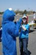 Picture of student volunteer high fiving a volunteer