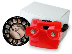 A custom View-Master style reel and viewer set with pictures of baby