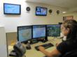 A Clean Harbors duty operator at an EOC workstation.