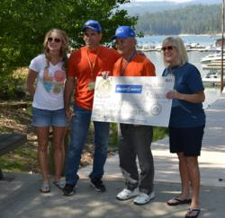 From Left, Michelle Miller from Miller's Landing and the Bass Lake Chamber of Commerce, Anthony Donato who netted the fish, $10,000 winner Pete Antonino, and Bass Lake Chamber of Commerce Treasurer Nancy Gunning pose with a check for $10,000 Antonino won