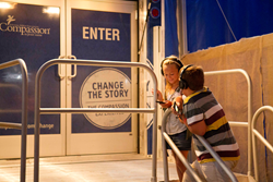 Young visitors listen to the story of a Compassion-sponsored child at the Mobile Experience.