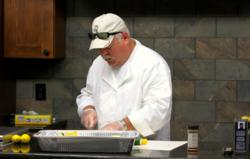 Chef Tom Rodgers preps food at the All Things Barbecue Test Kitchen.