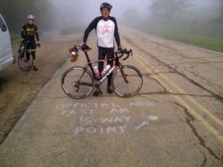 Cyclist Barry Haarde at halfway point of cross country tour near Topeka, Kansas