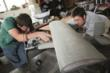 SDSM&T students Tyler Pojanowski (left) and David Haberman (right) inspect their history-making concrete airplane.