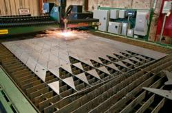 "Bluff Manufacturing's modern plasma cutter allows cutting of plates up to 2"" in thickness"