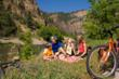 A family takes time for a picnic on a cycling excursion along the Glenwood Canyon Recreation Trail