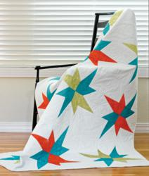 The Fractured Stars Quilt Pattern is a modern quilt design with timeless appeal.
