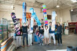 FIDM Graphic Design Students and Signal Snowboards employees with their boards