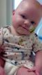 Haevyn is up and smiling just days after receiving a heart transplant in March, 2013.