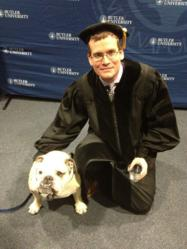 uthor John Green at Butler University Commencement with retired mascot Butler Blue II