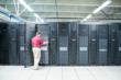 Mercy's Greg Green, data center administrator, changes out drives on disk storage units.