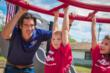 HGTV's Carter Oosterhouse encourages children as they cross the overhead climber at the new Tony Stewart Playground.