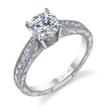 SY982: Diamond engagement ring by Sylvie Collection made with 18K white gold, 1 carat round center diamond and 0.32 carats of surrounding diamonds