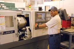 NSL Employee, Terrance Goolsby,  operates the Okuma Genos L250E.