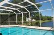 A screen pool enclosure from Venetian Builders, Inc., Miami. Heavier-gauge framing retains its delicate look but discretely adds strength.