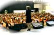 Deborah speaking to 3,000 audience