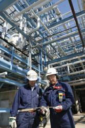 Engineers at oil refinery piping design