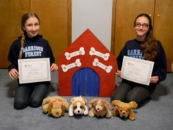Two Garrison Forest students hold up awards won in the Johns Hopkins Robotics Competition