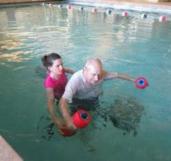 Abernethy Laurels resident James McAllister participating in his aquatic therapy session with Physical Therapy Assistant Jessica Snyder.