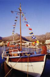 """Nautical Pennants displayed on a """"dressed"""" yacht."""