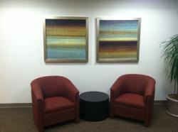 Two 40 inch square canvas office art prints installed by Hoffman Design Group