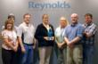 Reynolds Polymer employees pose with the trophy that they earned via the annual Colorado Manufacturing Awards in Denver.