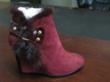 A Suede Ankle-Boot With Decorative Belt, Fur and Feather trim
