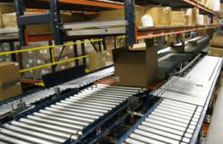 Carton routed on TGW converyor based on the order barcode ID