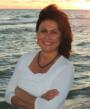 Compassionate Tough Love Coach Paula Renaye, author of the award-winning Living the Life You Love