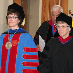 United President Wendy Deichmann and Bishop Peggy Johnson of the Philadelphia Area of the UMC walk in the processional during United's Spring Commencement.
