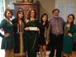 """Klein Forest High School PISA, Mayera Iqbal, Alondra Silva, Neidy Giron, Shazia Shah and Advisor Dr. Norman LaFave, present a check for $2,000 they raised the money during their 2013 Spring PISA Culture Shock Charity Show to benefit Hashoo Foundation's """"Plan Bee"""""""