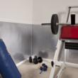 Weight room with Fasade wall panels in Diamond Plate style.