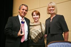 Pierre-Yves Dietrich, MD, PhD, accepts the Cancer Researcher of the Year Award from Eveline Mumenthaler of The Gateway for Cancer Research (middle) and Kay Kays, who is a specially-trained patient advocate serving on Gateway's Board of Scientific Counselors.