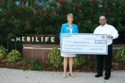 AmeriLife CEO Tim North presents the company's donation for OK tornado victims to Judy Whitney of the American Red Cross, Tampa Bay Chapter.