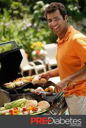 Man grilling over a barbecue